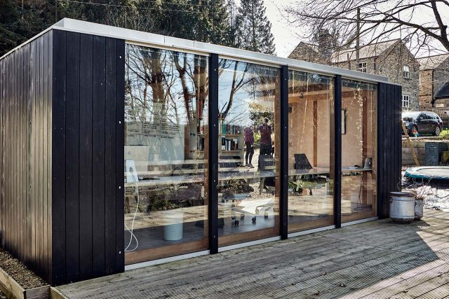 Modular garden room with black cladding